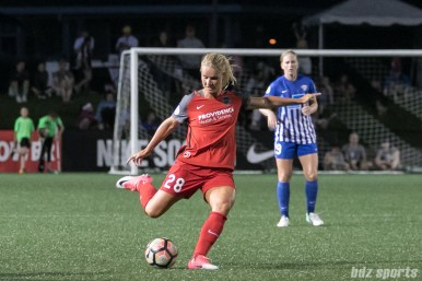Portland Thorns FC midfielder Amandine Henry (28) sends the ball up the field.