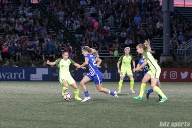Breakers' Christen Westphal #20 takes the ball up the midfield.