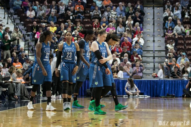 Minnesota Lynx starters take the court at the start of the game.