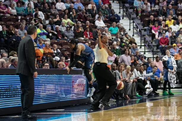 Minnesota Lynx forward Maya Moore (23) jumps onto the screen at mid-court while attempting to keep the ball in-bounds.