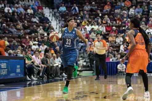 Minnesota Lynx forward Seimone Augustus (33) brings the ball down the court.