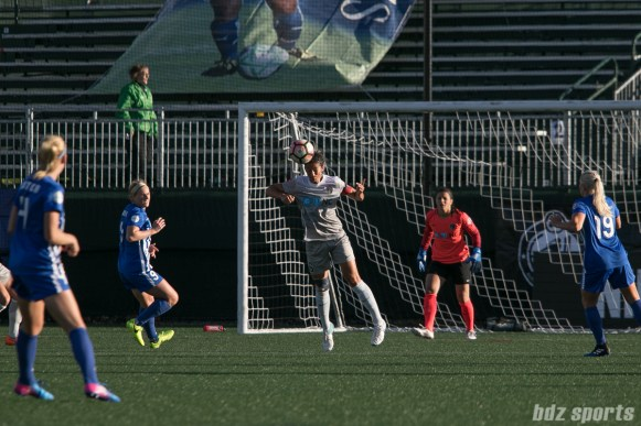 Courage's Abby Erceg #6 heads the ball away.