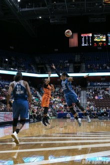 Minnesota Lynx forward Maya Moore (23) attempts to block Connecticut Sun guard Alex Bentley (20) 3-point shot.