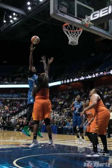 Minnesota Lynx center Sylvia Fowles (34) looks to float the ball over Connecticut Sun forward Lynetta Kizer (12).