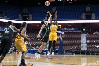 Sky's Cappie Pondexter #23 takes a shot over the hand of Liberty's Bria Hartley #8.