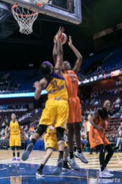 Sparks' Avery Warley-Talbert #32 attempts to block the Sun's Jonquel Jones #35