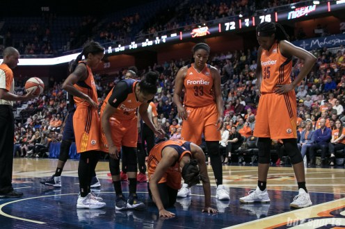 Sun players check in on teammate Jasmine Thomas #5 after she caught a foot to the head.