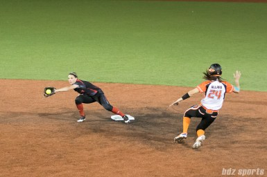Akron Racers shortstop Ashley Thomas (1) looks to tag out Chicago Bandits outfielder Emily Allard (24).