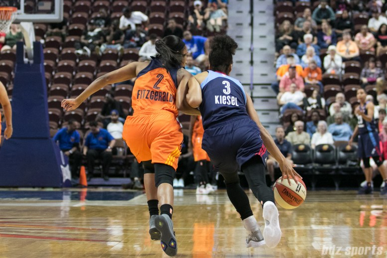 Atlanta Dream guard Brianna Kiesel (3) takes on Connecticut Sun guard Feyonda Fitzgerald (2).