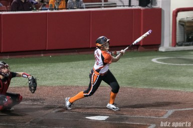Chicago Bandits utility player Taylah Tsitsikronis (65) watches her hit head into right field.