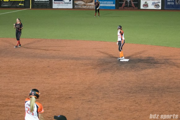 Chicago Bandits outfielder Brenna Moss (55) air-fist bumps teammate Chelsea Forkin (25) during the 5th inning.