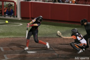 Akron Racers outfielder Jennifer Gilbert (25) connects for a two-run homerun in the top of the 7th inning.