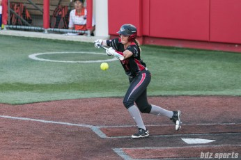 Akron Racers second baseman Ashley Thomas (1) lays down a bunt.