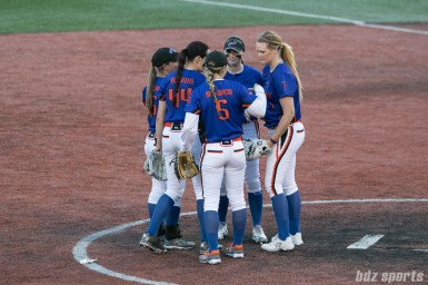 Chicago Bandits infielders huddle before the start of the next inning.