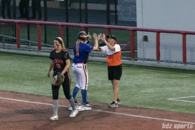 Chicago Bandits outfielder Emily Crane (3) high fives the first base coach after her base hit.