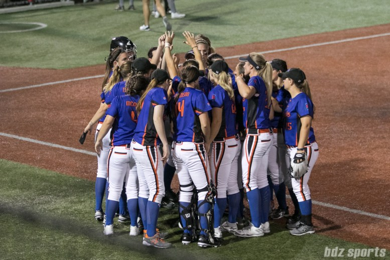 The Chicago Bandits huddle before the start of the bottom of the inning.