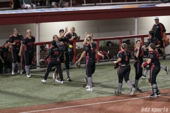 The Akron Racers high five before the start of the next inning.