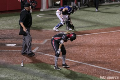 Akron Racers second baseman Ashley Thomas (1) reacts after getting hit by a pitch in the face.
