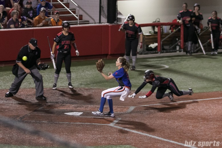 Akron Racers outfielder Taylor Schlopy (2) steals home after an errant pitch.