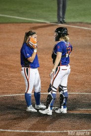 Chicago Bandits pitcher Haylie Wagner (17) and catcher Taylore Fuller (22) talk on the mound.