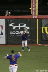 Chicago Bandits outfielder Samantha Poole (25) makes the catch for the out.