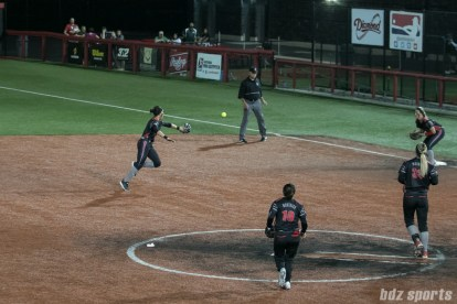 Akron Racers second baseman Alex Hugo (16) scoops and throws out the runner at first using her glove hand.
