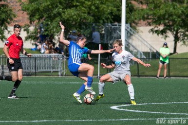 Boston Breakers midfielder Amanda DaCosta (5) makes a move past North Carolina Courage midfielder McCall Zerboni (7).