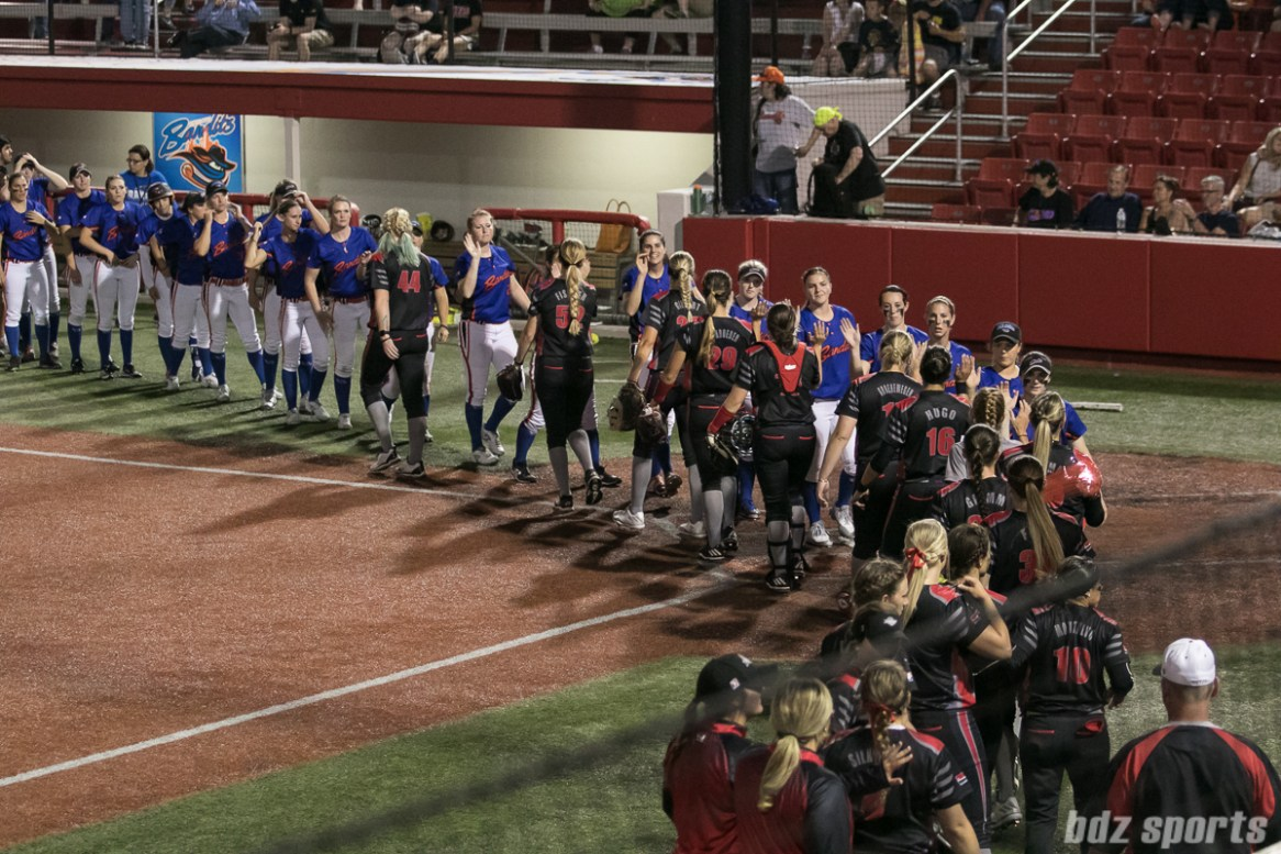 The Chicago Bandits and Akron Racers shake hands after the game.