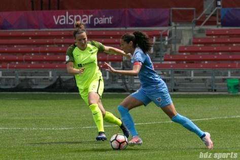 Chicago Red Stars forward Christen Press (23) takes on Seattle Reign FC defender Rachel Corsie (4).