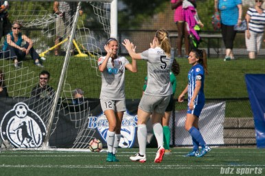North Carolina Courage forward Ashley Hatch (12) high fives teammate midfielder Sam Mewis (5) after scoring off a pass from Mewis.