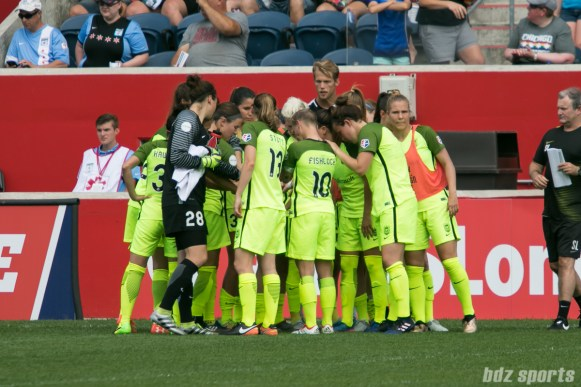 The Seattle Reign FC huddle before the start of the second half.