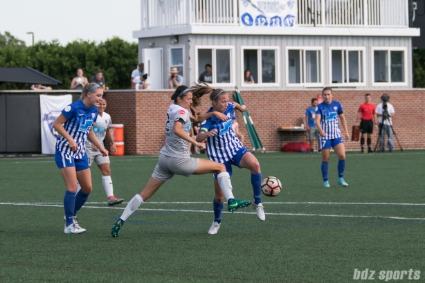 North Carolina Courage forward Ashley Hatch (12) and Boston Breakers defender Julie King (8) battle for a loose ball in the box.