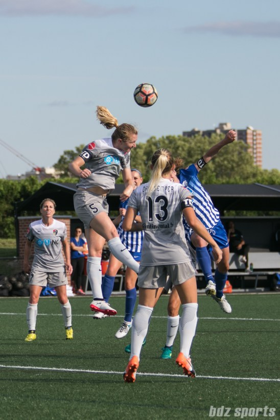 North Carolina Courage midfielder Sam Mewis (5) heads the ball away from danger.