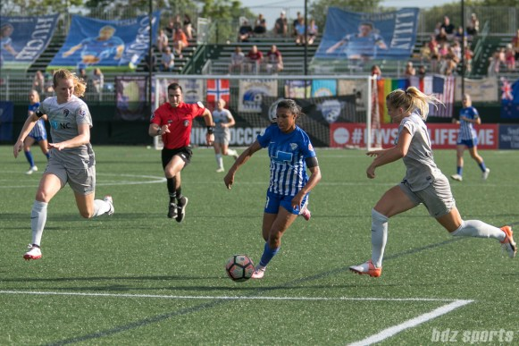 Boston Breakers forward Midge Purce (21) dribbles between to North Carolina Courage players.