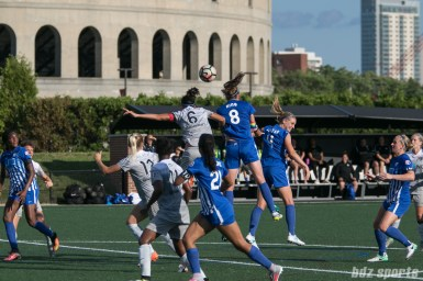 North Carolina Courage defender Abby Erceg (6) challenges Boston Breakers defender Julie King (8) for a ball in the air.