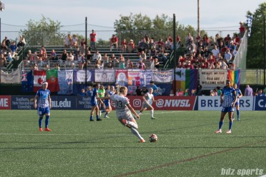 North Carolina Courage defender Abby Dahlkemper (13) takes a free kick against the Boston Breakers.