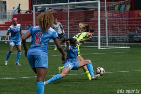 Chicago Red Stars midfielder Vanessa DiBernardo (10) attempts to keep Seattle Reign FC forward Katie Johnson (33) off the ball.