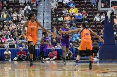 Connecticut Sun center Jonquel Jones (35) high fives teammate Jasmine Thomas (5).
