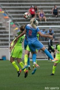 Chicago Red Stars defender Julie Ertz (8) challenges Seattle Reign FC defender Rebekah Stott (13) in the air for the ball.