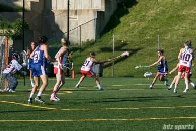 Long Island Sound attacker Aly Messigner (5) takes a shot on goal.