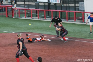 Chicago Bandits outfielder Alexa Peterson (14) slides to beat the throw to first base.