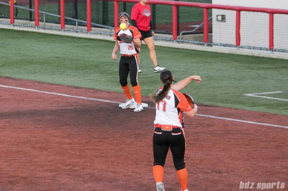 Chicago Bandits pitcher Haylie Wagner (17) throws to first baseman Chelsea Forkin (25) for the out.