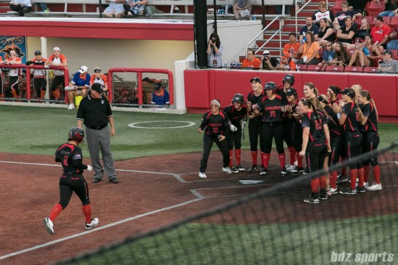 Akron Racers outfielder Taylor Schlopy (2) is greeted by her teammates after hitting a homerun in the top of the 3rd inning.