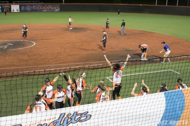 The Chicago Bandits celebrate the RBI single by third baseman Stacy May Johnson (5).