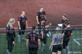 Players on the Akron Racers play hacky sack before the start of the game.