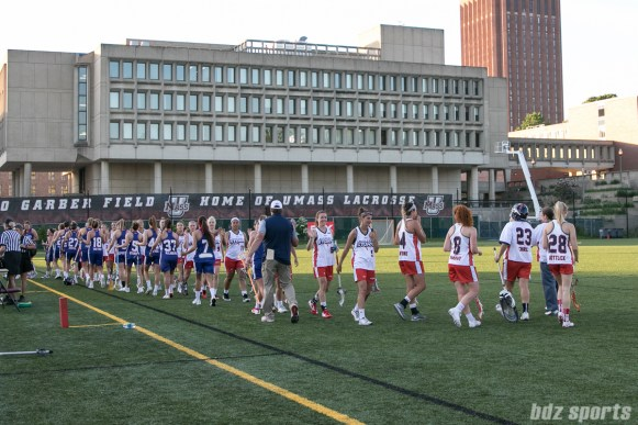The Boston Storm and Long Island Sound shake hands after the game. The Sound won 10 - 9 over the Storm.
