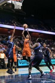 Connecticut Sun guard Courtney Williams (10) splits the Atlanta Dream defense for a layup.