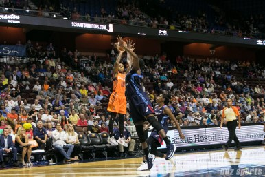 Connecticut Sun guard Courtney Williams (10) takes a shot over the outstreched arms of Atlanta Dream center Elizabeth Williams (1).