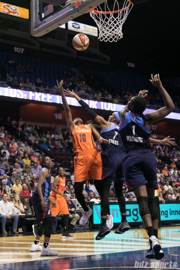 Atlanta Dream guard Brittney Sykes (7) attempts to block the layup by Connecticut Sun guard Courtney Williams (10).