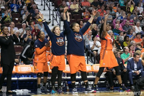 The Connecticut Sun bench celebrating a 3-pointer.